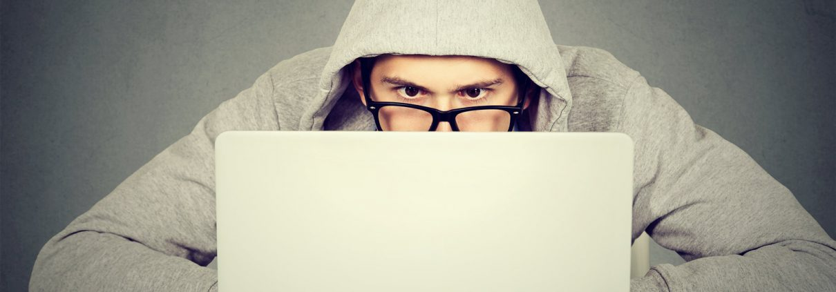 Blueskyrisk - Cyber Risk Underwriters -Young man using a laptop